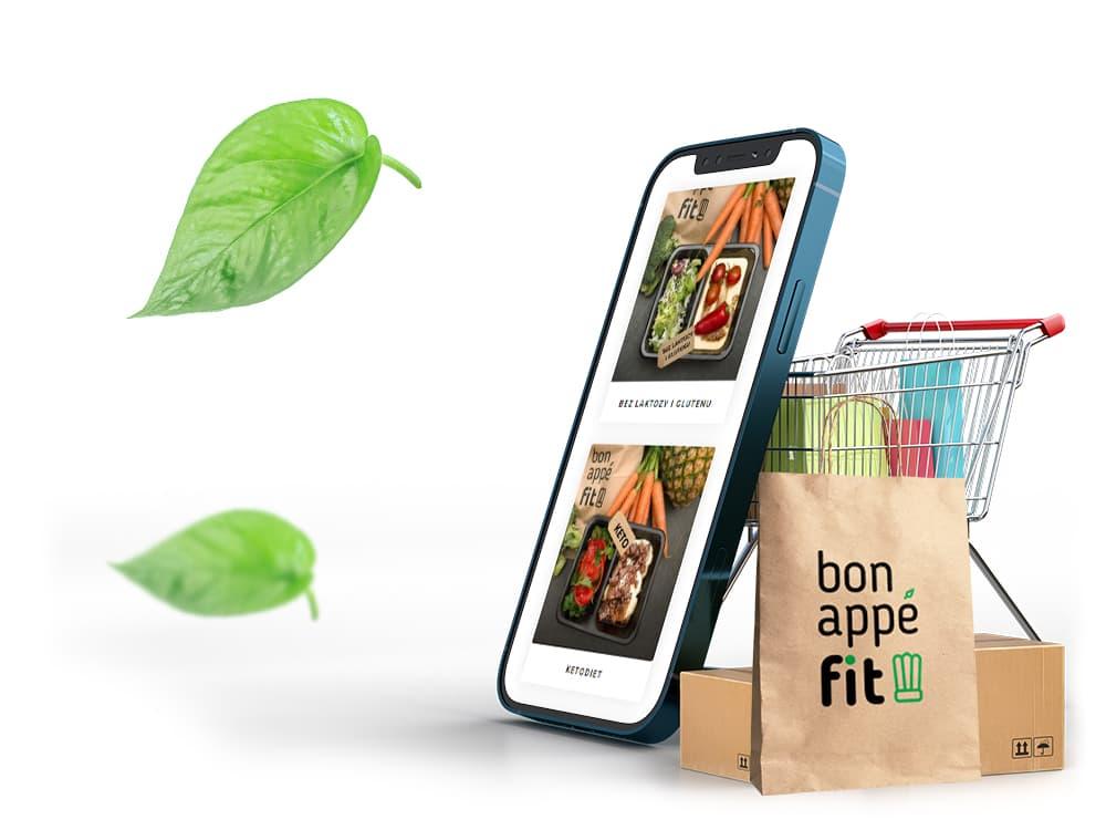Telefon z stroną bonappefit i torbą